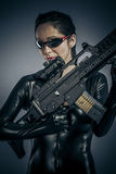 Criminal, Sexy girl military woman posing with guns. Stock Photo