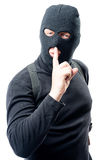 Criminal shows his hand a finger near his lips asking. For a quieter Royalty Free Stock Image