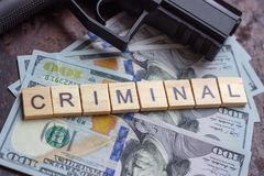 Criminal sign on usa dollars background. Black market, contract killing, mafia and crime concept. Criminal sign on usa dollars background. Black market stock photo
