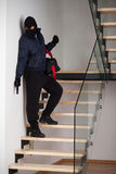 Criminal on staircase Stock Photos