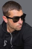 Criminal with sunglasses looking at camera Royalty Free Stock Images