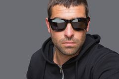 Criminal with sunglasses looking at camera Royalty Free Stock Photos