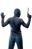 Criminal terrorist with hands up isolated on white. Background Stock Photo