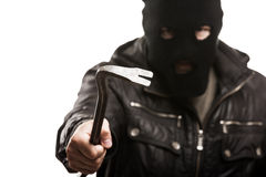 Criminal thief or burglar man in balaclava or mask holding crowb Royalty Free Stock Photo