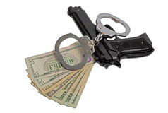 Criminal tools. A gun , handcuff and money, three crime relevant objets are together on a white background royalty free stock photography