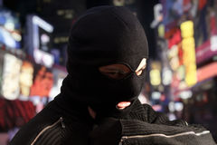 Criminal wearing black mask Royalty Free Stock Images
