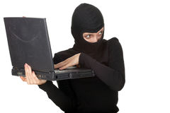 Criminal woman with the laptop Stock Photos