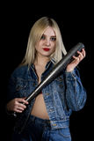 Criminal young woman with baseball bat, young hooligan in jeans and a denim jacket Stock Photos