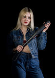 Criminal young woman with baseball bat, young hooligan in jeans and a denim jacket Royalty Free Stock Images