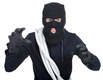 Criminality. Male offender from Balaklava in the head with a rope. Isolated on white background stock images