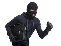 Criminality. Portrait of running male burglar with a handbag. Isolated on white background royalty free stock photos