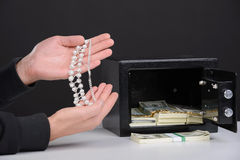 Criminality. Thief burglar stealing money during home safe codebreaking stock photo