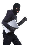 Criminality. Thief stealing a laptop computer. Isolated on white background royalty free stock photos