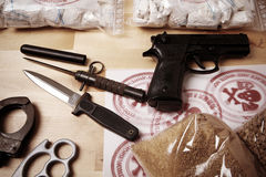 Criminality, violence and drugs. Drug packages, raw opium, drug dozens and weapons seized by police stock photos
