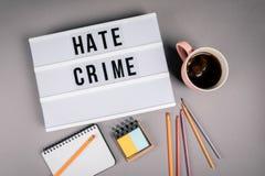 Crimine di odio Testo in scatola leggera fotografie stock libere da diritti