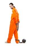 Criminel dans la robe longue orange en prison images libres de droits