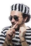 Criminoso engraçado do prisioneiro do homem com bola chain e algemas no stu Fotografia de Stock Royalty Free