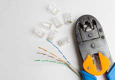 Crimper, connectors and ethernet cable Stock Image