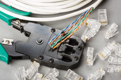 Crimper and network cable Royalty Free Stock Image