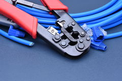 Crimping tool with cable for computer network Royalty Free Stock Photos