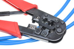 Crimping tool with a computer network cable Stock Images