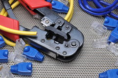 Crimping tool with network cable and connectors. On metal surface Stock Photo