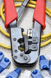 Crimping tool with network cable and connectors. On metal surface Royalty Free Stock Image