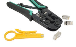 Crimping tool with a network cable isolated Stock Images