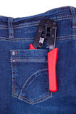 Crimping tool in a pocket of jeans Royalty Free Stock Photo