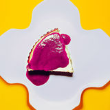 Crimson cake on yellow background Royalty Free Stock Photos