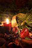 Crimson Christmas. Low key still life of Christmas decorations in reds and greens Stock Image