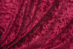 Crimson crushed velvet with soft folds Stock Photo