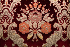 Crimson fabrics with golden pattern Stock Photo
