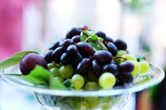 Crimson grape, bunch of grapes, grapes in the plate Royalty Free Stock Image