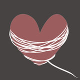 Crimson heart with white rope on gray background Stock Images