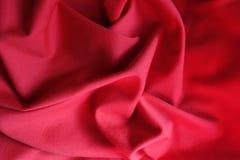 Crimson jersey fabric in soft folds. Crimson red jersey fabric in soft folds Royalty Free Stock Photography