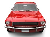 Crimson red American vintage muscle car - front view. Isolated on white background Stock Image