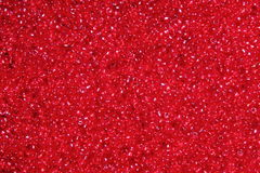 Crimson-red glass beads background - closeup beads texture Stock Image