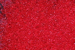 Crimson-red glass beads background - closeup beads texture Royalty Free Stock Photography