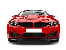 Crimson red modern sport racing car - front view closeup shot Stock Photos