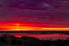 Crimson Sunrise. Amazing crimson/red sunrise over Benbrook Lake in Fort worth, TX Stock Image
