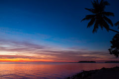 Crimson sunset over the sea . Maldives Stock Photography