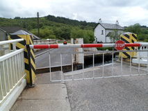 Crinan Canal Road Swing Bridge. Crinan Canal, Argyll, Scotland has been a working canal since it opened 200 years ago. Connecting canal to lochs and ocean. The Stock Images