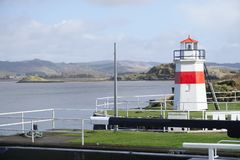 Crinan harbour at canal entrance and lighthouse in Argyll and Bute Scotland. Uk stock photos