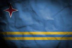 Crinked pappersbakgrund med att blanda den Aruba flaggan Royaltyfria Bilder