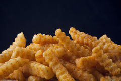 Crinkle cut French fries. Closeup image of crinkle cut French fries Royalty Free Stock Images