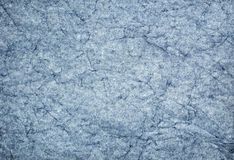 Crinkled Blue Paper. Blue paper that has been crumpled and is being illuminated from behind to create a unique and abstract background Stock Photo