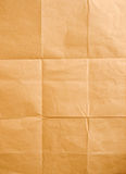 Crinkled brown paper. Background of old wrinkled and folded paper Stock Photography