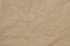 Crinkled brown paper background. Texture Stock Photos