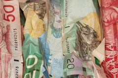 Crinkled Canadian dollar bills closeup Stock Photo
